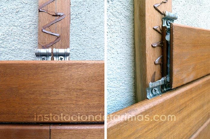 Foto de la aplicación del adhesivo en el rastrel y en la hembra de la testa de la tarima exterior durante el montaje de un muro recubierto con tarima