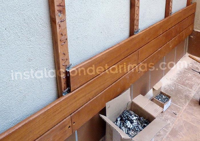 Foto de el paso a paso parahacer un muro recubierto con tarima.